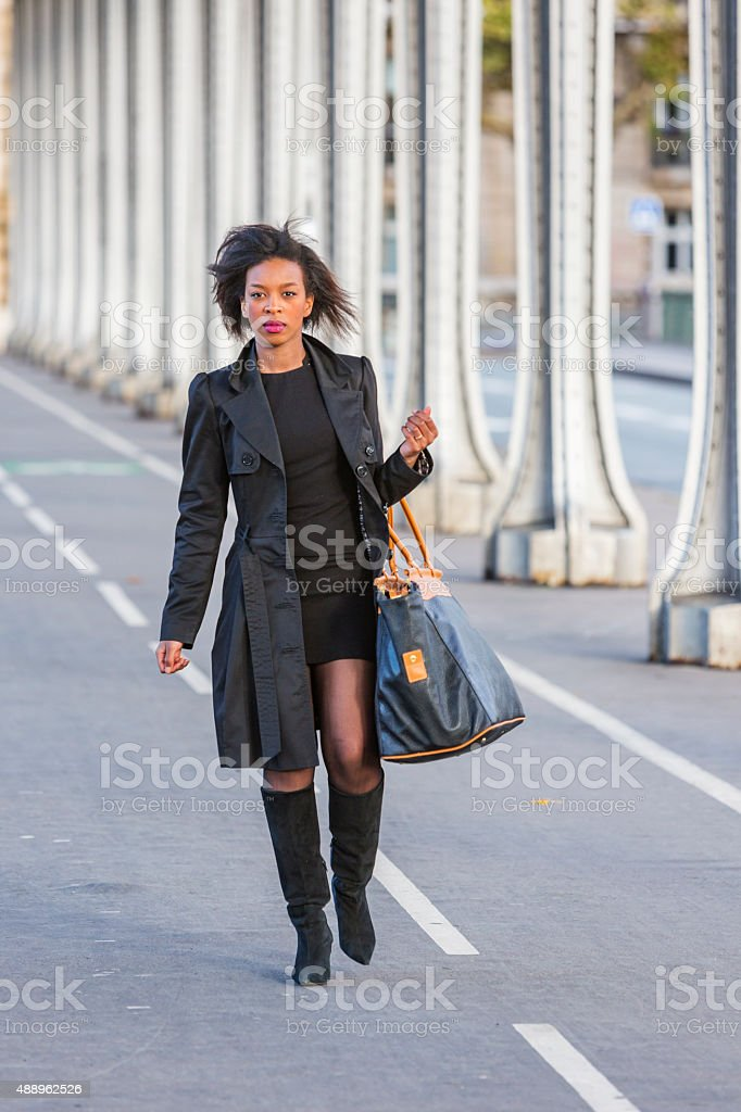 Stylish Young African Woman Walking in Paris stock photo