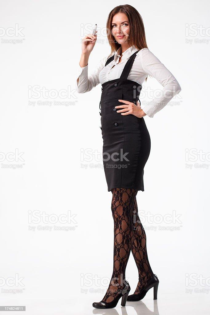 Stylish young businesswoman writing isolated on white background royalty-free stock photo