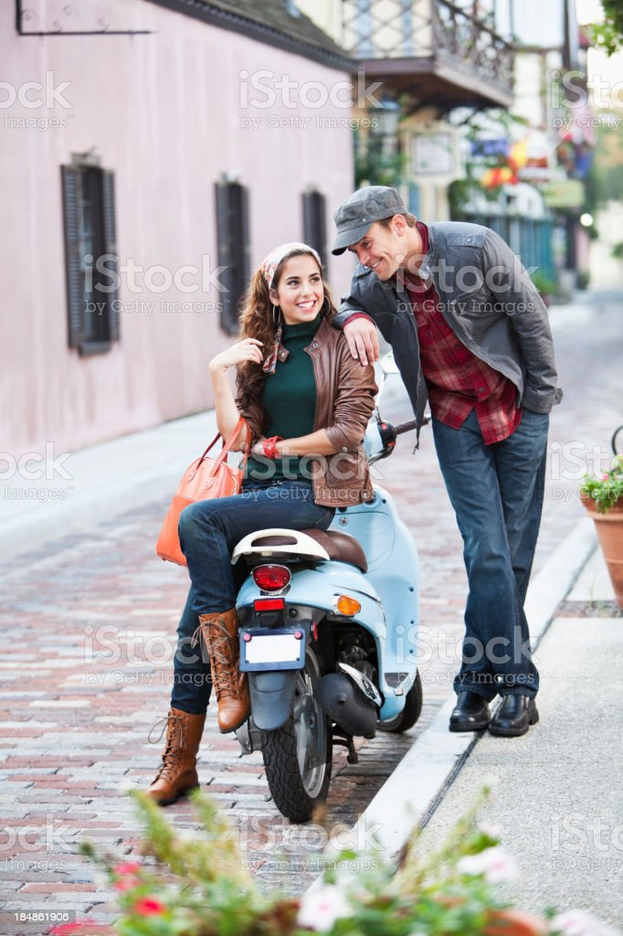 Stylish young couple flirting on cobblestone street royalty-free stock photo