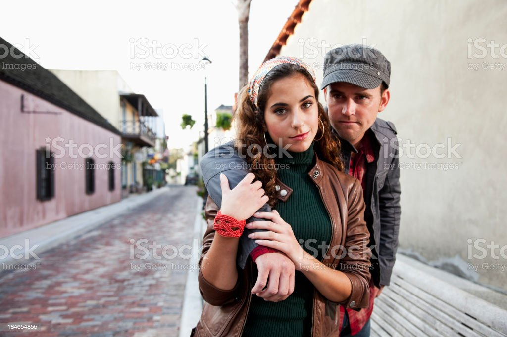 Stylish young couple on urban street royalty-free stock photo