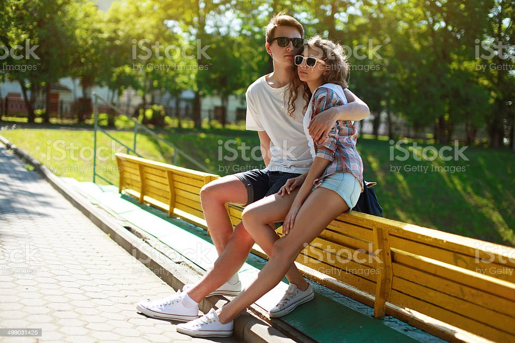 Stylish young couple teenagers in love, summer sunny day stock photo