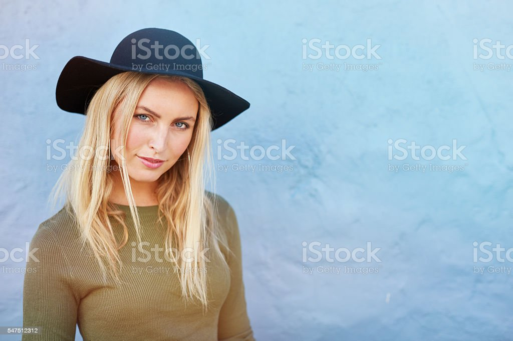 Stylish young female model with hat stock photo