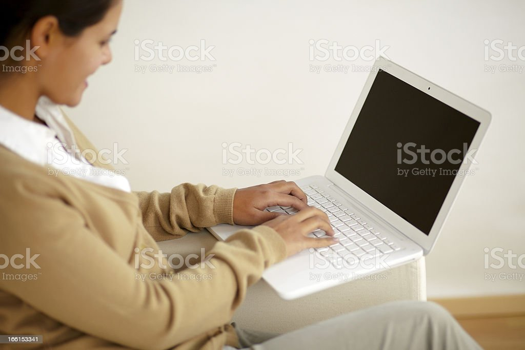Stylish young female working with laptop computer royalty-free stock photo