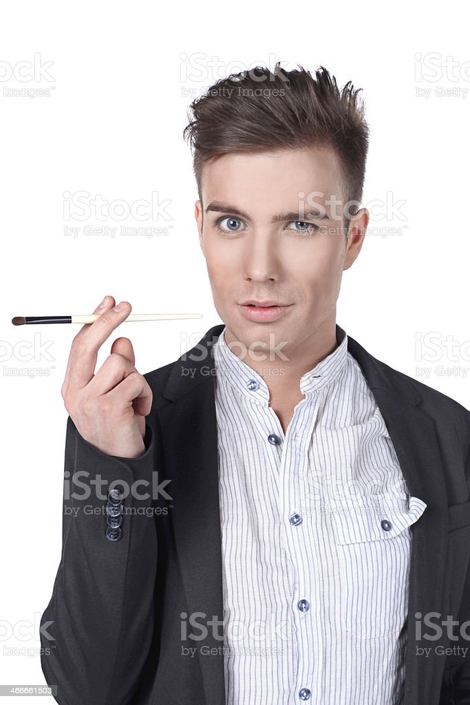 Stylish young handsome man in a suit with a brush. stock photo