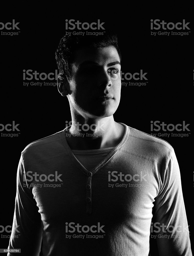 stylish young man portrait in low-key stock photo
