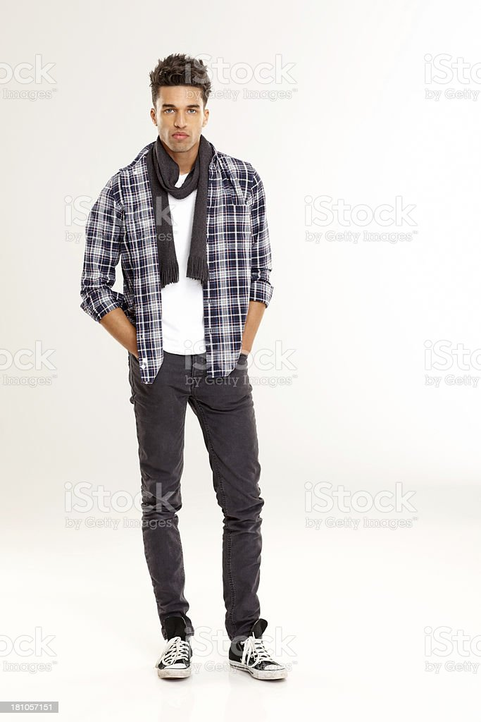 Stylish young man posing over white background royalty-free stock photo