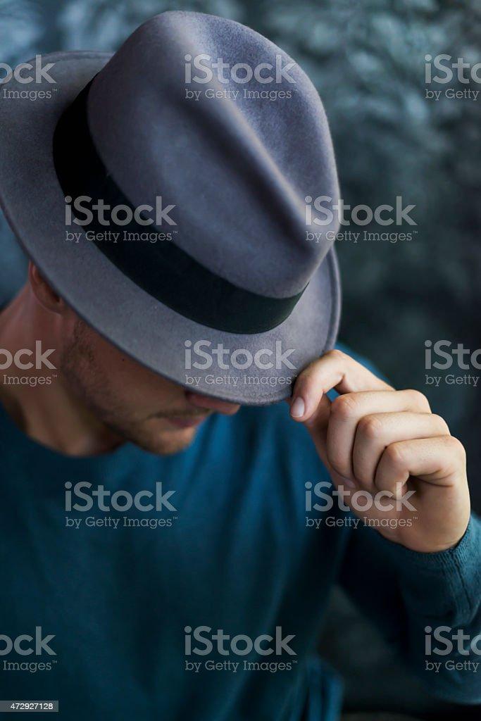 Stylish young man wearing a fedora stock photo