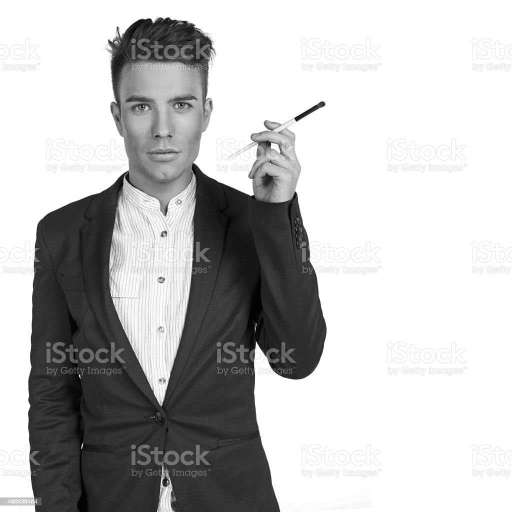 stylish young men with make up brush in the studio stock photo