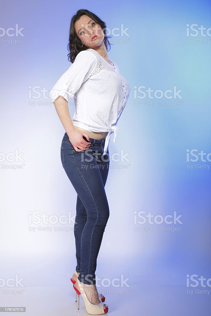 stylish young plus size model in fashion jeans royalty-free stock photo