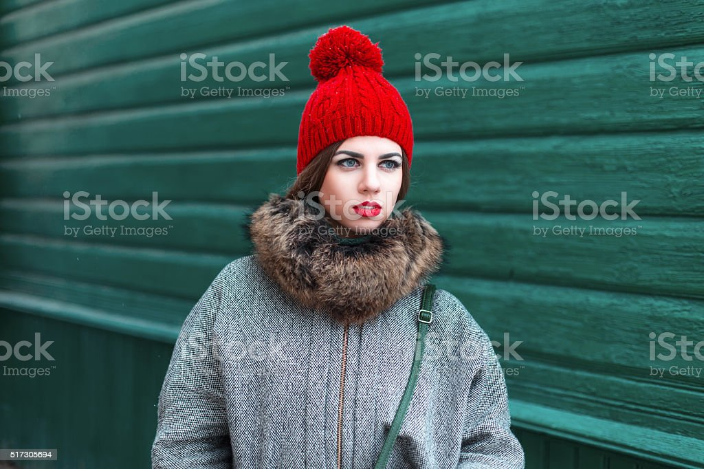 Stylish young Russian girl in fashionable winter clothes stock photo