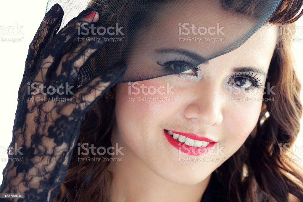 Stylish young woman in black bonnet looking at camera stock photo