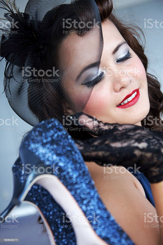 Stylish young woman in black bonnet looking at shoes stock photo