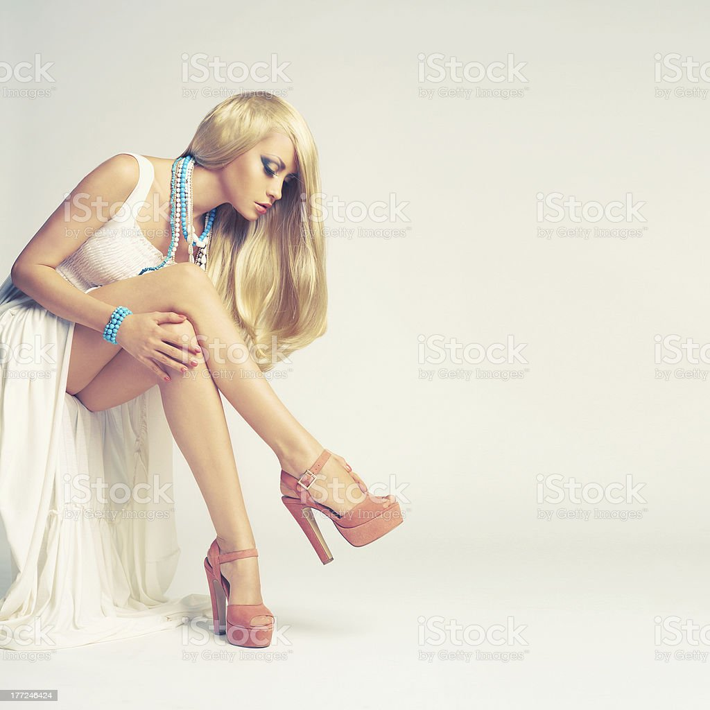 Stylish young woman on white background royalty-free stock photo