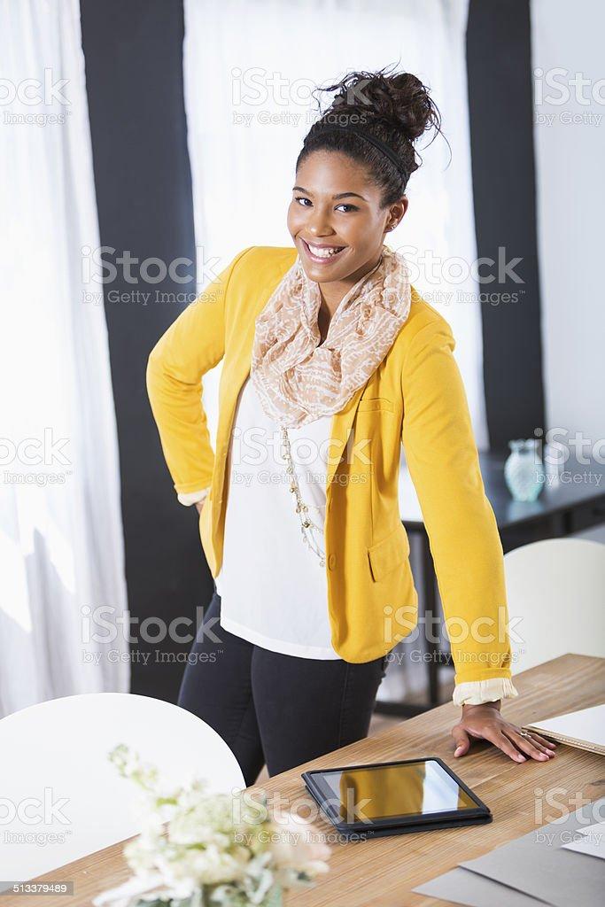 Stylish young woman working stock photo