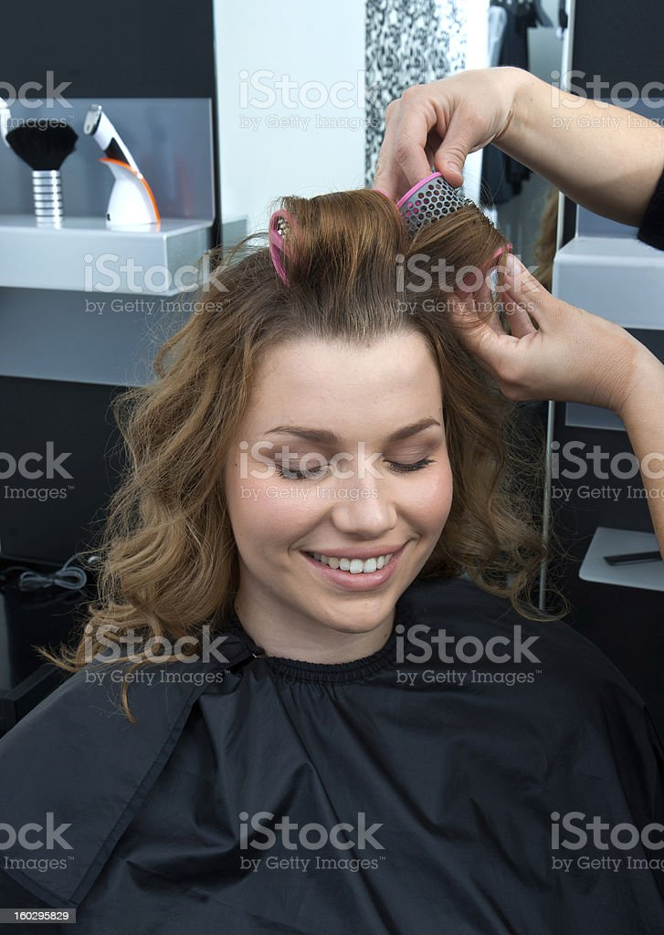stylist curling woman hair in salon royalty-free stock photo