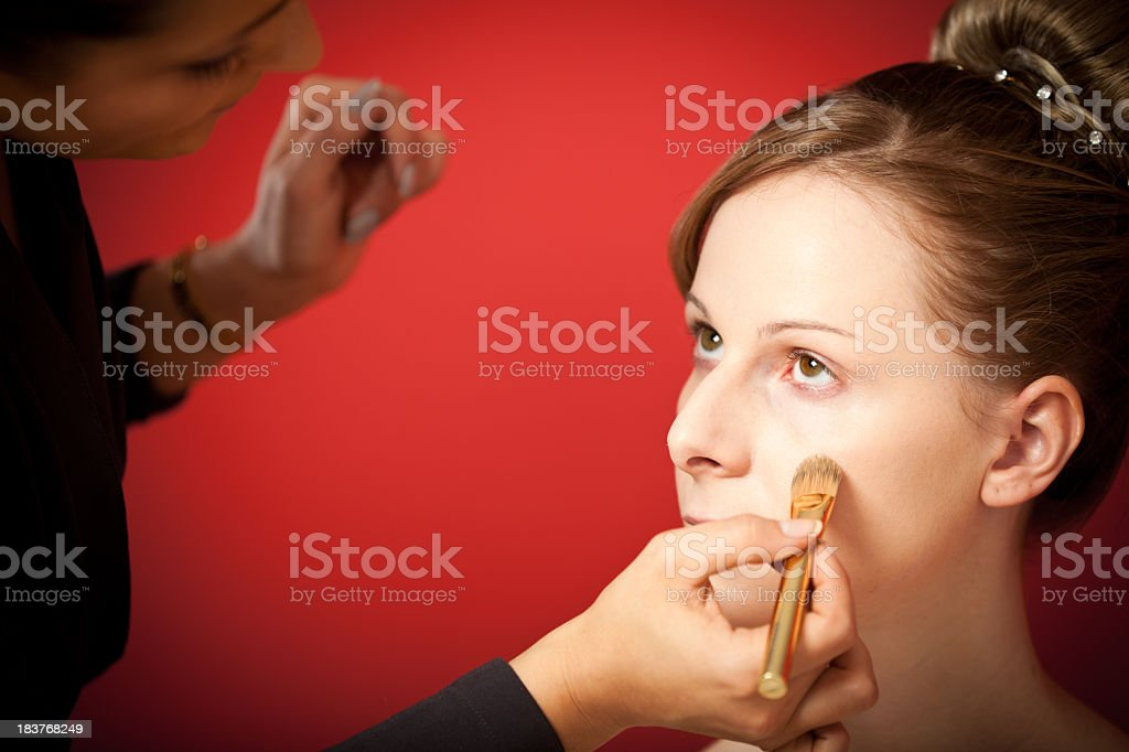 stylist making up the bride royalty-free stock photo