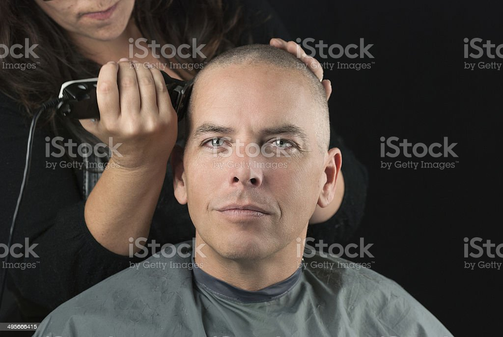 Stylist Shaves Mans Head stock photo