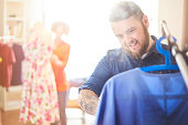 stylist steaming a garment
