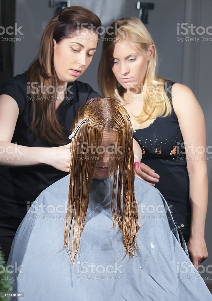 stylist training young specialist of work withclient in salon stock photo