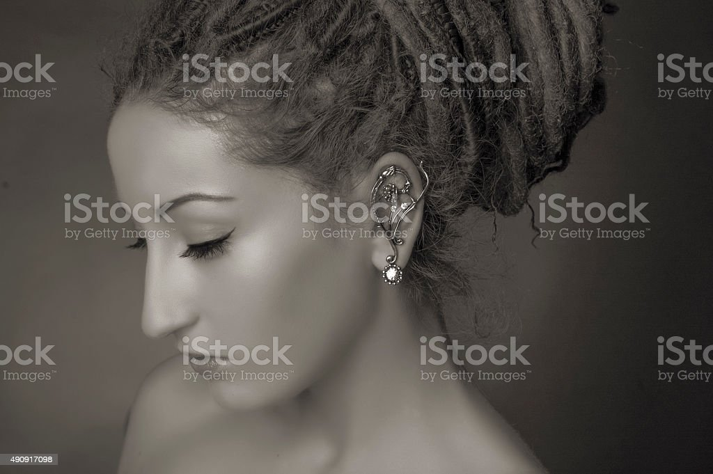 Stylized fashion shoot. Woman with a dreadlocks bun hairstyle stock photo