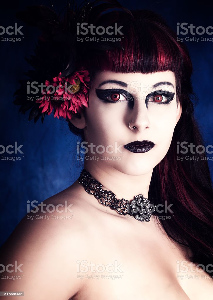 Stylized vertical colour portrait of serious female vampire stock photo