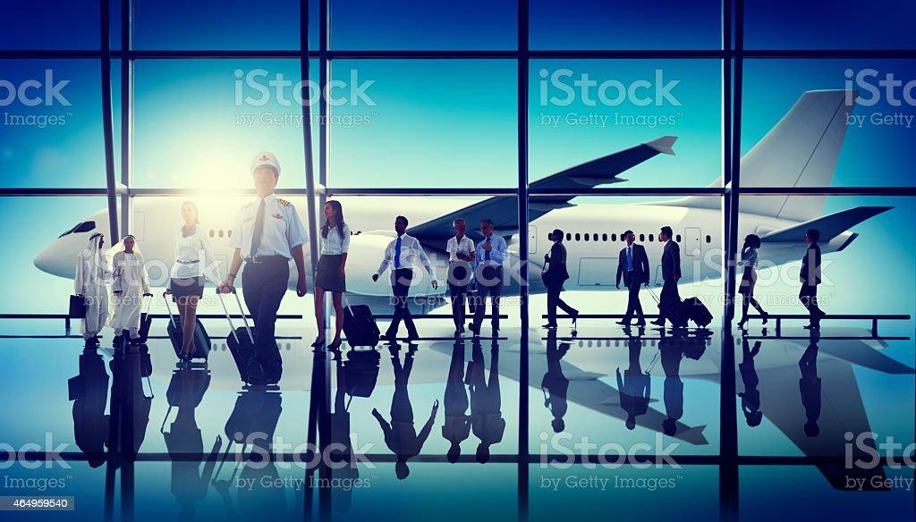 Stylized view of crew and passengers disembarking a plane stock photo