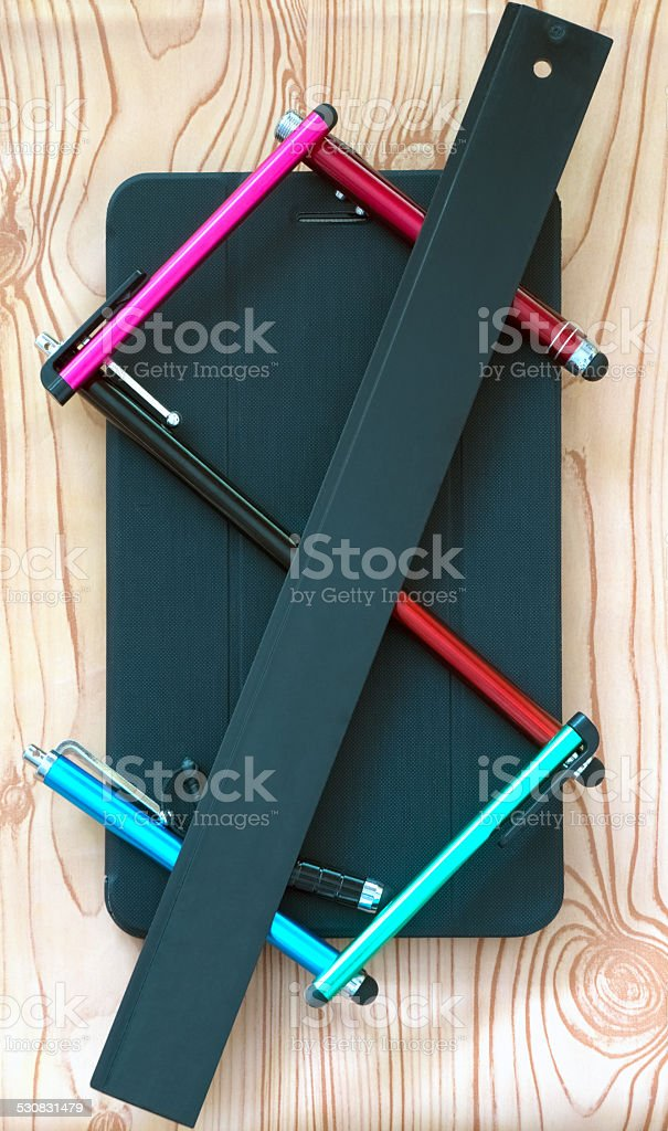 Styluses, lying on the 7 inch tablet, stock photo