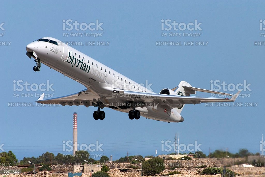 Styrian Sprirt CRJ-700 taking off stock photo
