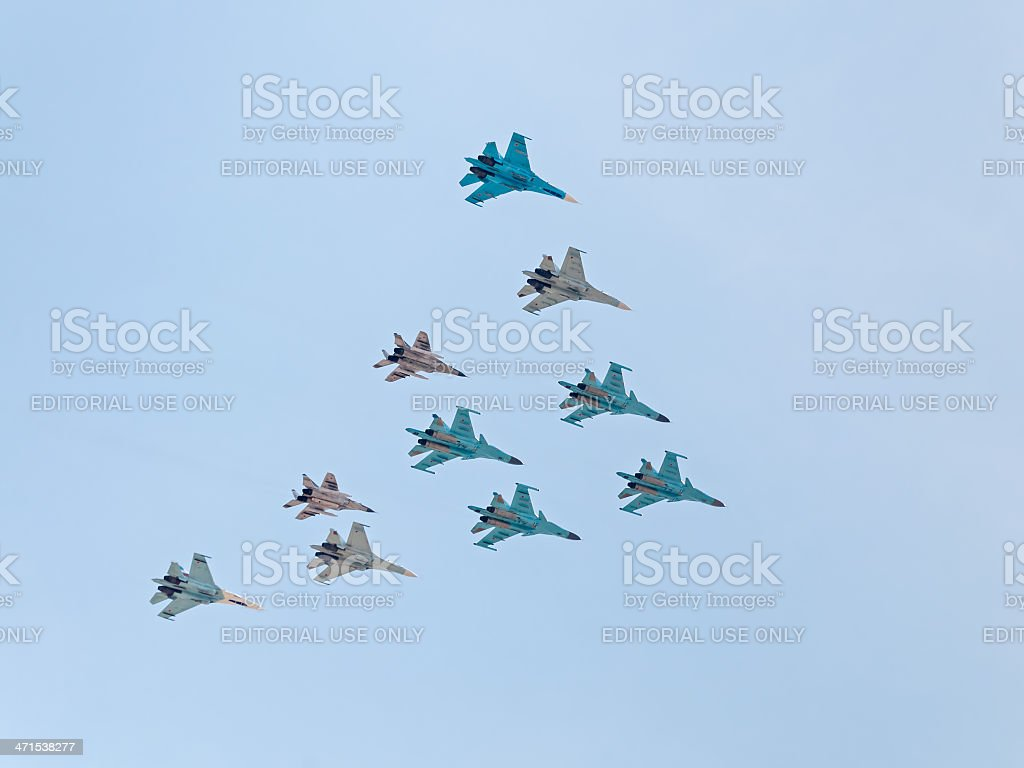 Su-34, Su-27, MiG-29 form aerobatic triangle figure against sky background royalty-free stock photo