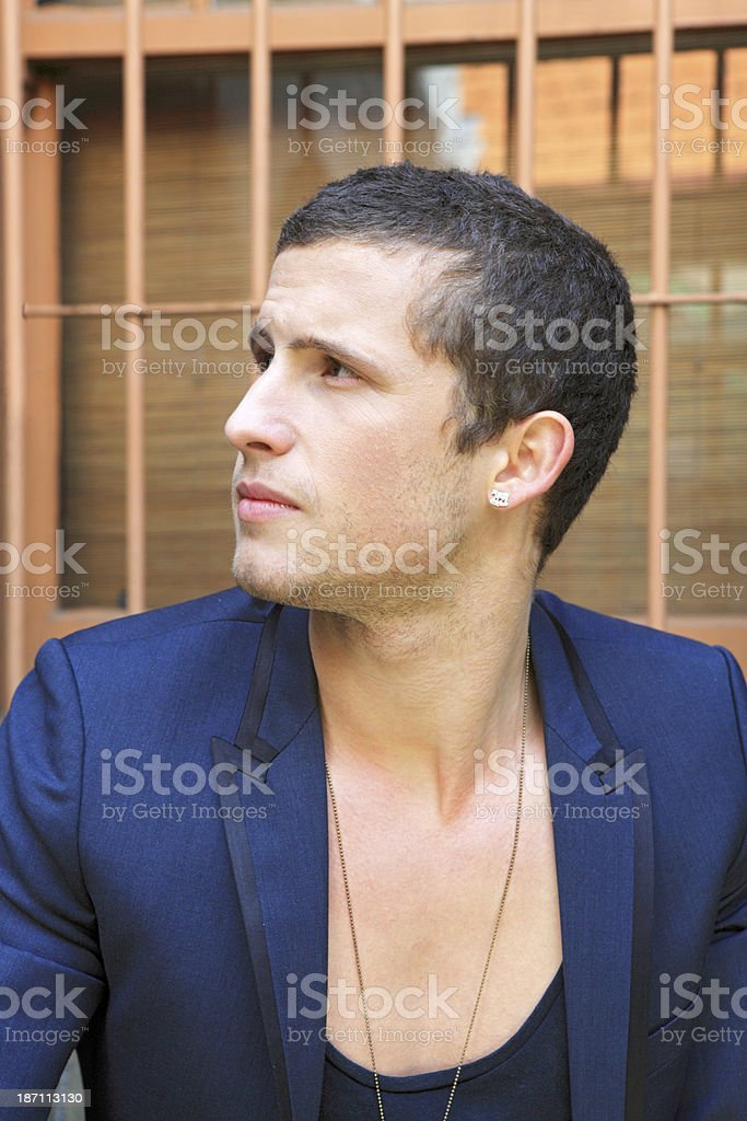 Suave young adult man looking up and wondering royalty-free stock photo