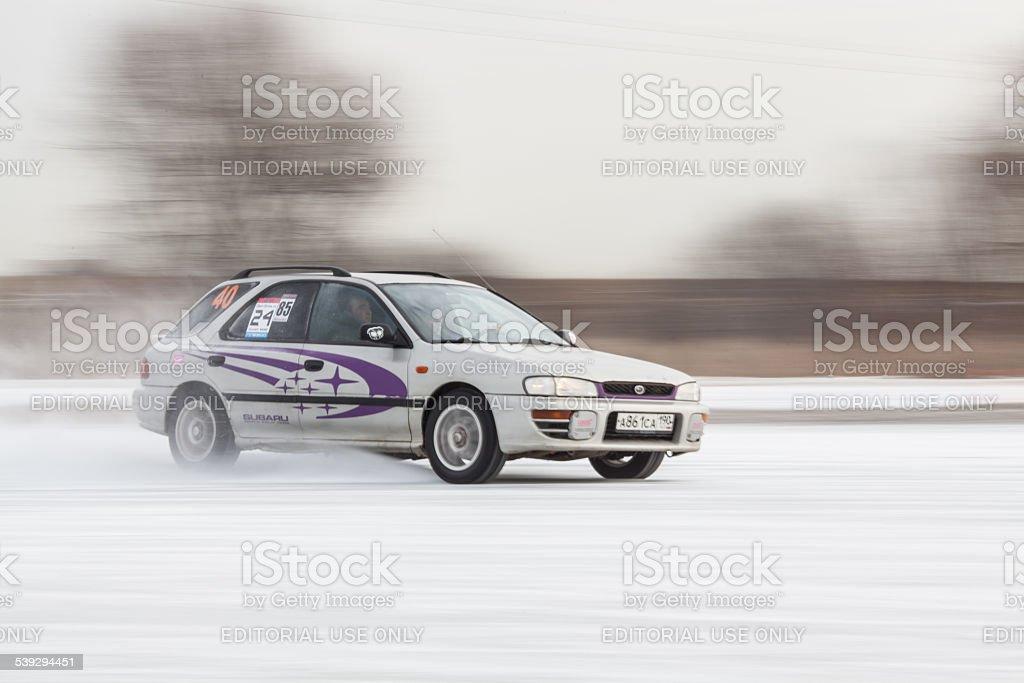 Subaru Impreza on ice track stock photo