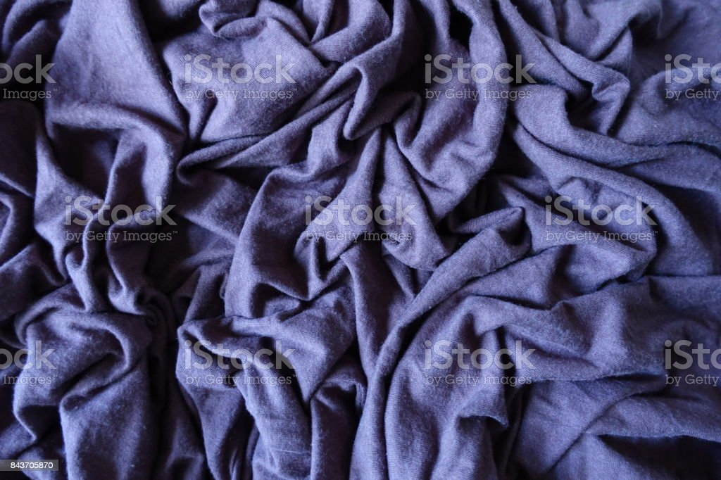 Subdued violet blue stockinet fabric in folds stock photo