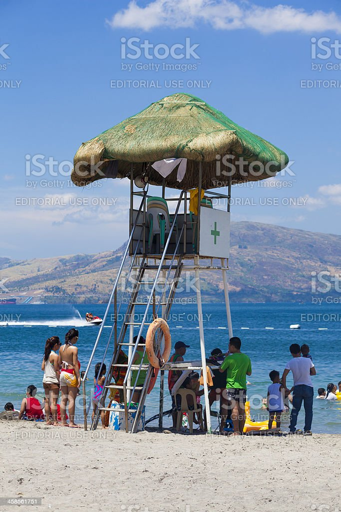 Subic, Philippines: Lifeguard hut at Crowded beach over Easter stock photo