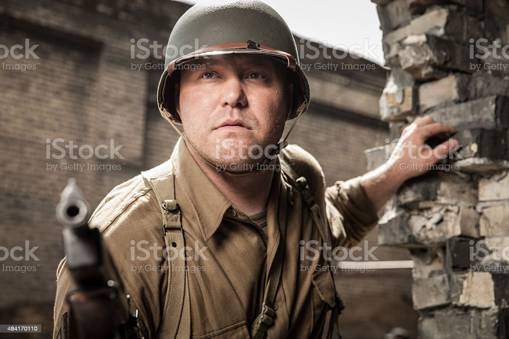WWII Submachine Gunner Sneaks Up on Enemy Outpost stock photo