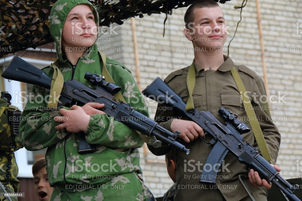 Submachine gunners in the back of a military truck. Russia stock photo