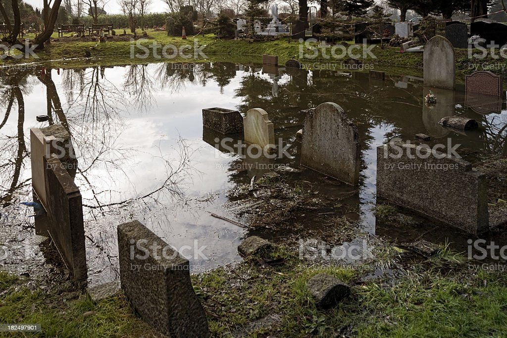 Submerged gravestones in a cemetery royalty-free stock photo