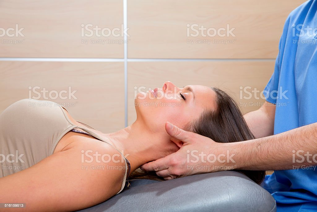 suboccipital massage therapy to woman with doctor hands stock photo