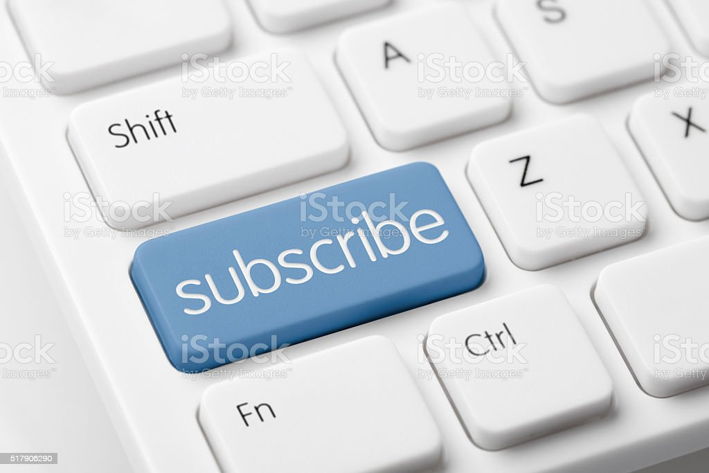 subscribe button on white computer keyboard stock photo