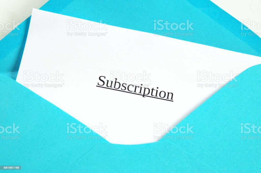 Subscription printed on white paper and blue envelope, white background stock photo