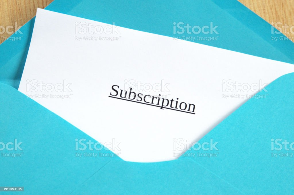 Subscription printed on white paper and blue envelope, wooden background stock photo