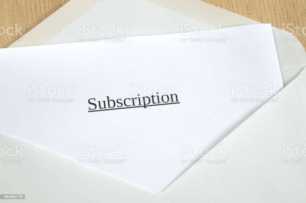 Subscription printed on white paper and envelope, wooden background stock photo
