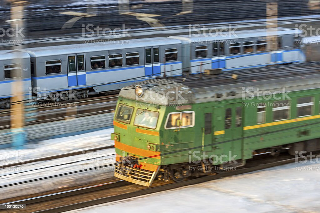 Suburban electric and metro trains in motion royalty-free stock photo