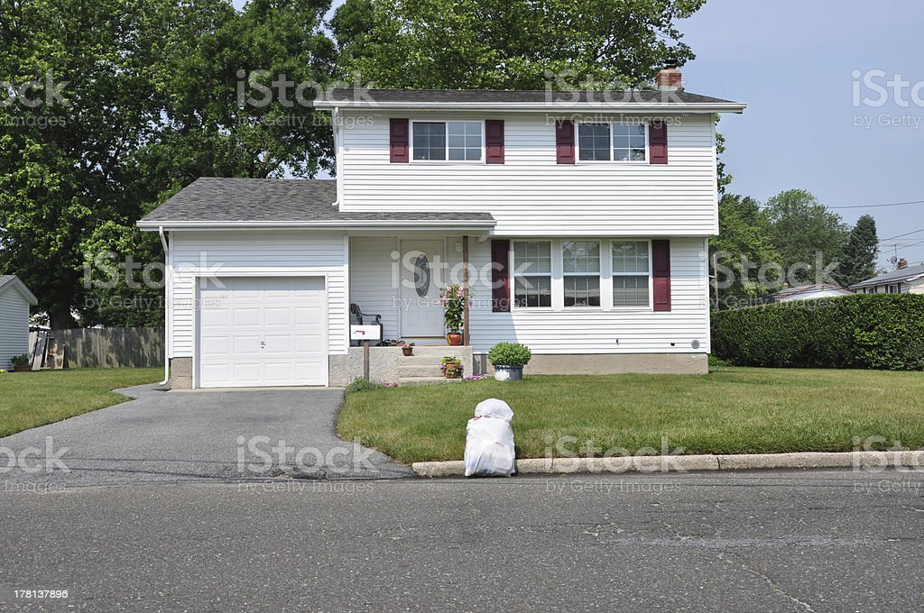 Suburban High Ranch Home Trash Day stock photo