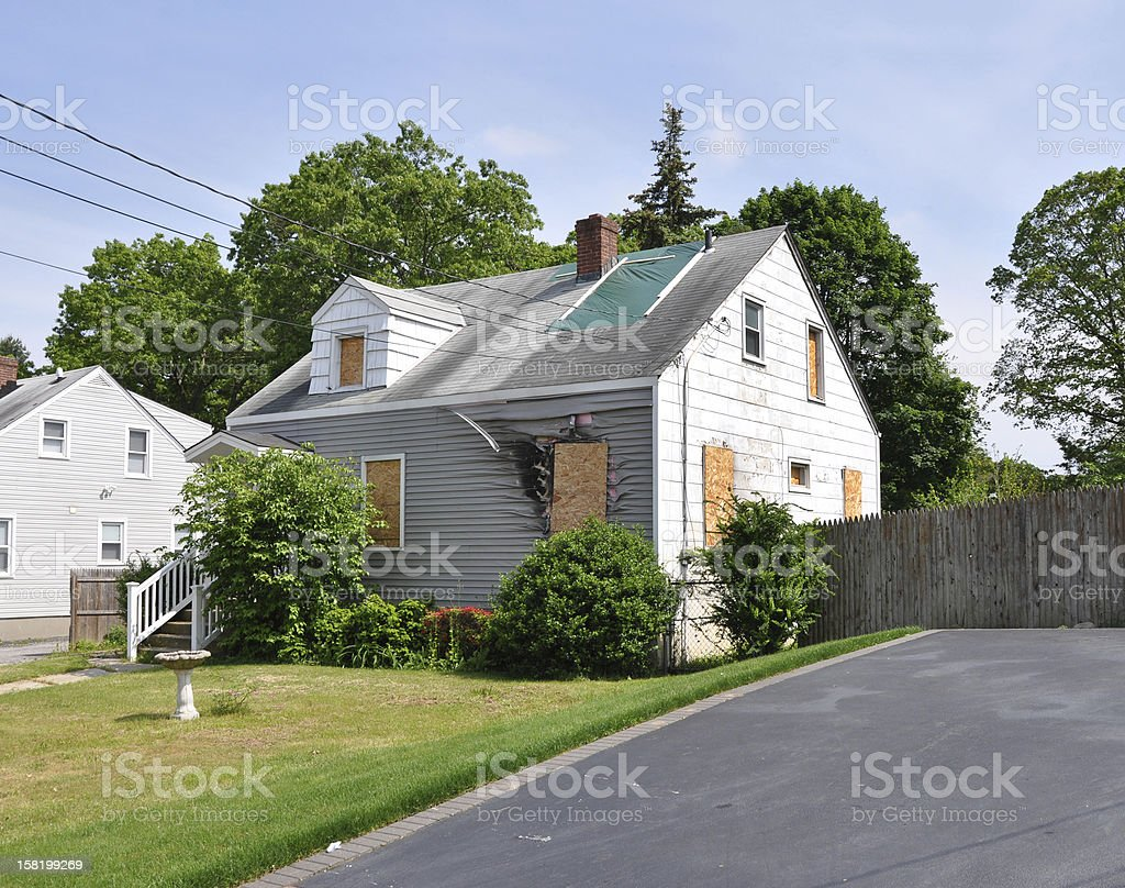 Suburban Home Fire Damage Boarded Windows stock photo