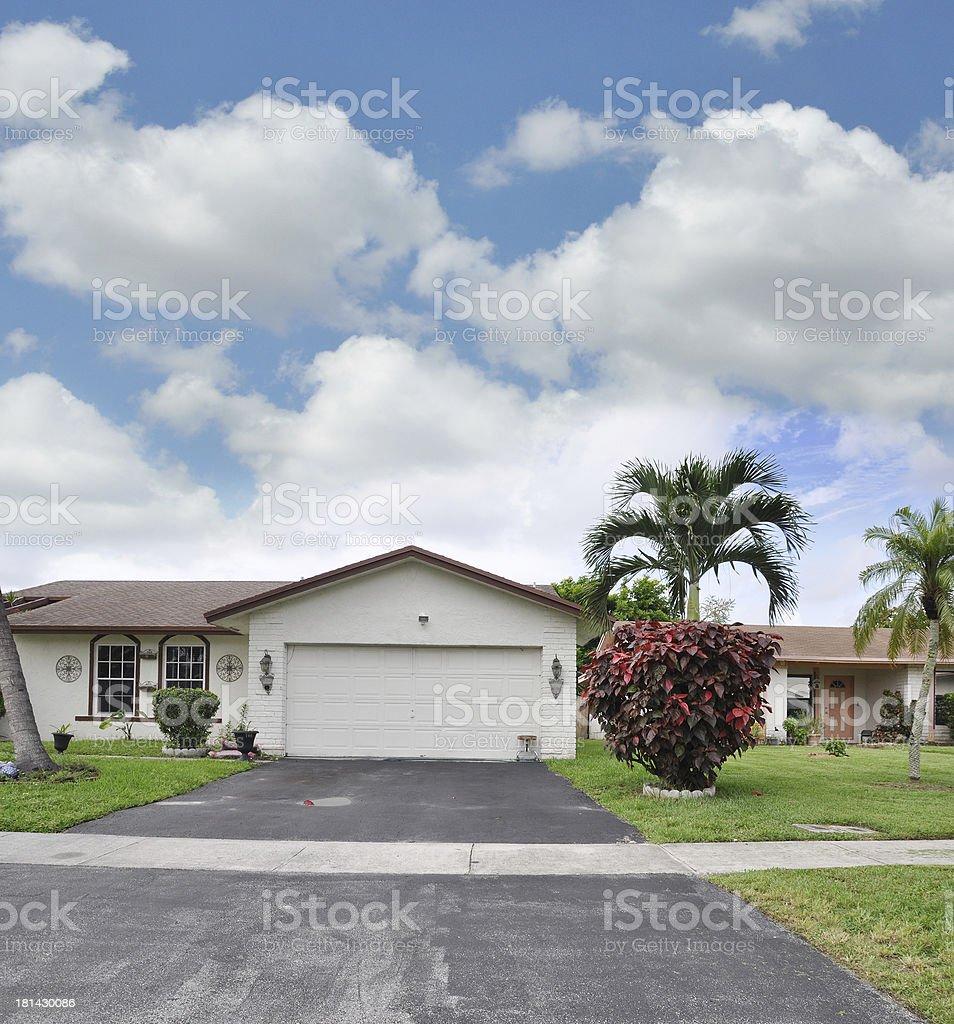 Suburban Home Garage Driveway Red Elm Bush royalty-free stock photo