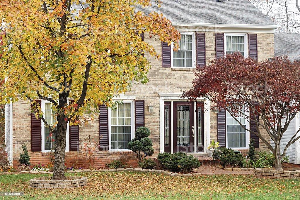 Suburban house in autumn stock photo