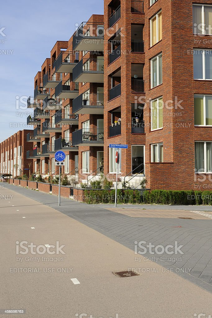 Suburban houses with sidewalk and bicycle lane in Leidsche Rijn royalty-free stock photo
