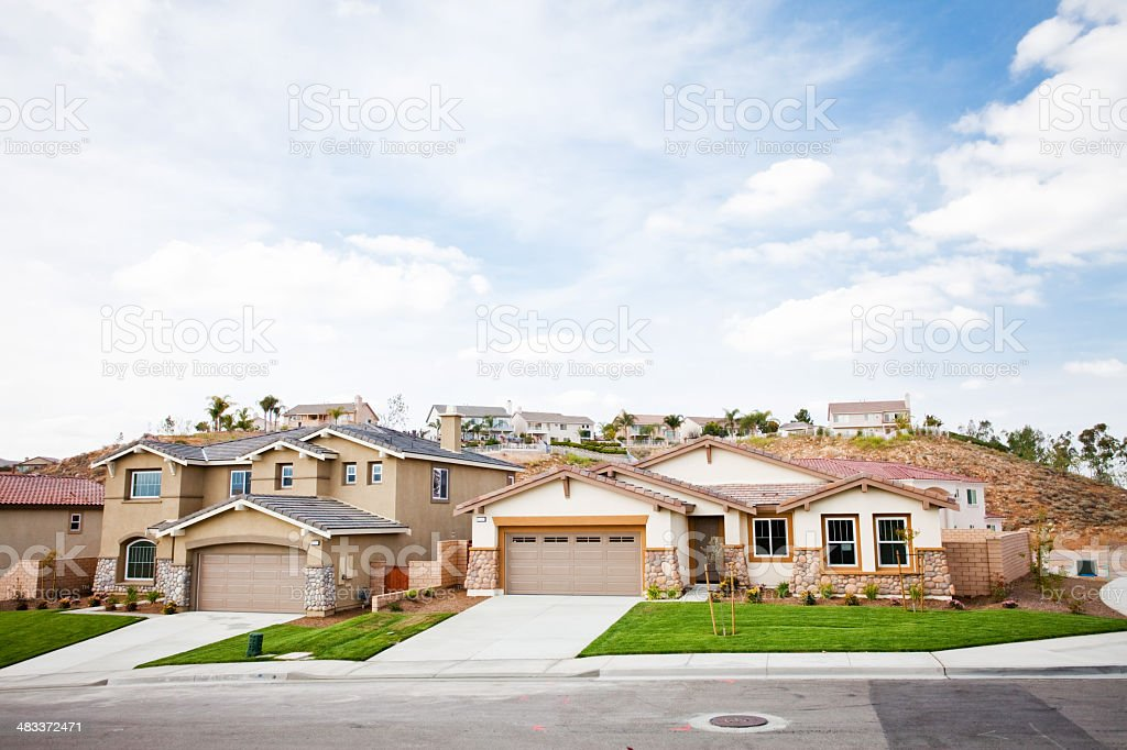 suburban neighborhood with clouds royalty-free stock photo