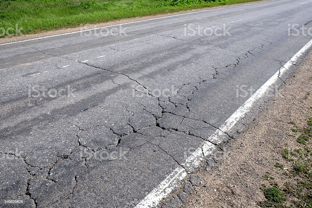 Suburban road in bad condition stock photo