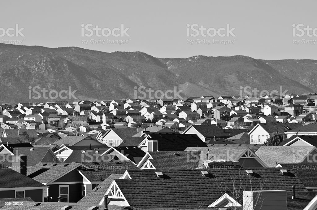 Suburban Rooftops Against the Rocky Mountains stock photo